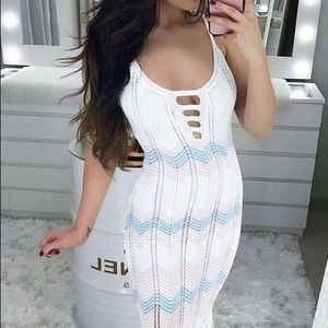 White knitted dress, with blue and pink stripes.